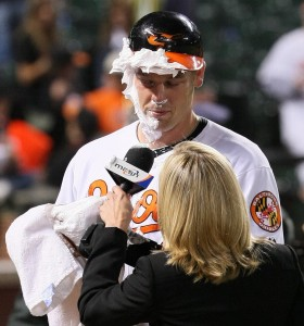 A TV reporter interviews a shaving cream-covered Matt Wieters in 2009.