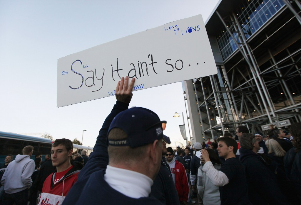 "Penn State fan with ""Say it ain't so"" sign"